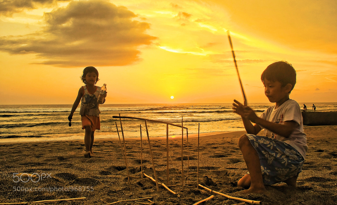 Photograph Kids Playing On The Beach by Maria Marganingsih on 500px