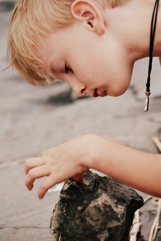 Photograph The Boy with The Stone by Tiuku Pennola on 500px