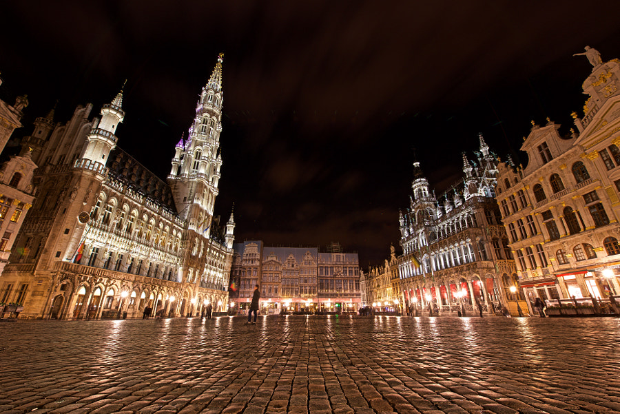 The Grand Place or Grote Markt is the central square of Brussels. It is surrounded by opulent guildhalls and two larger edifices, the city's Town Hall, and the Breadhouse building containing the Museum of the City of Brussels.