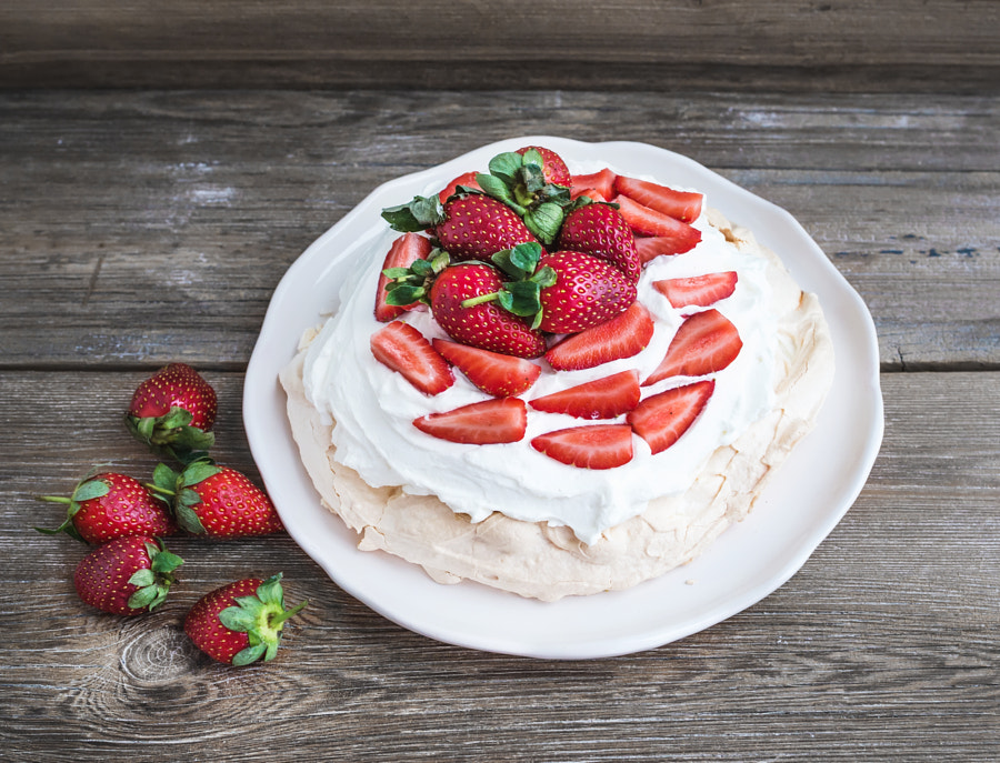 Rustic Pavlova cake with fresh strawberries and whipped cream ov by Anna Ivanova on 500px.com