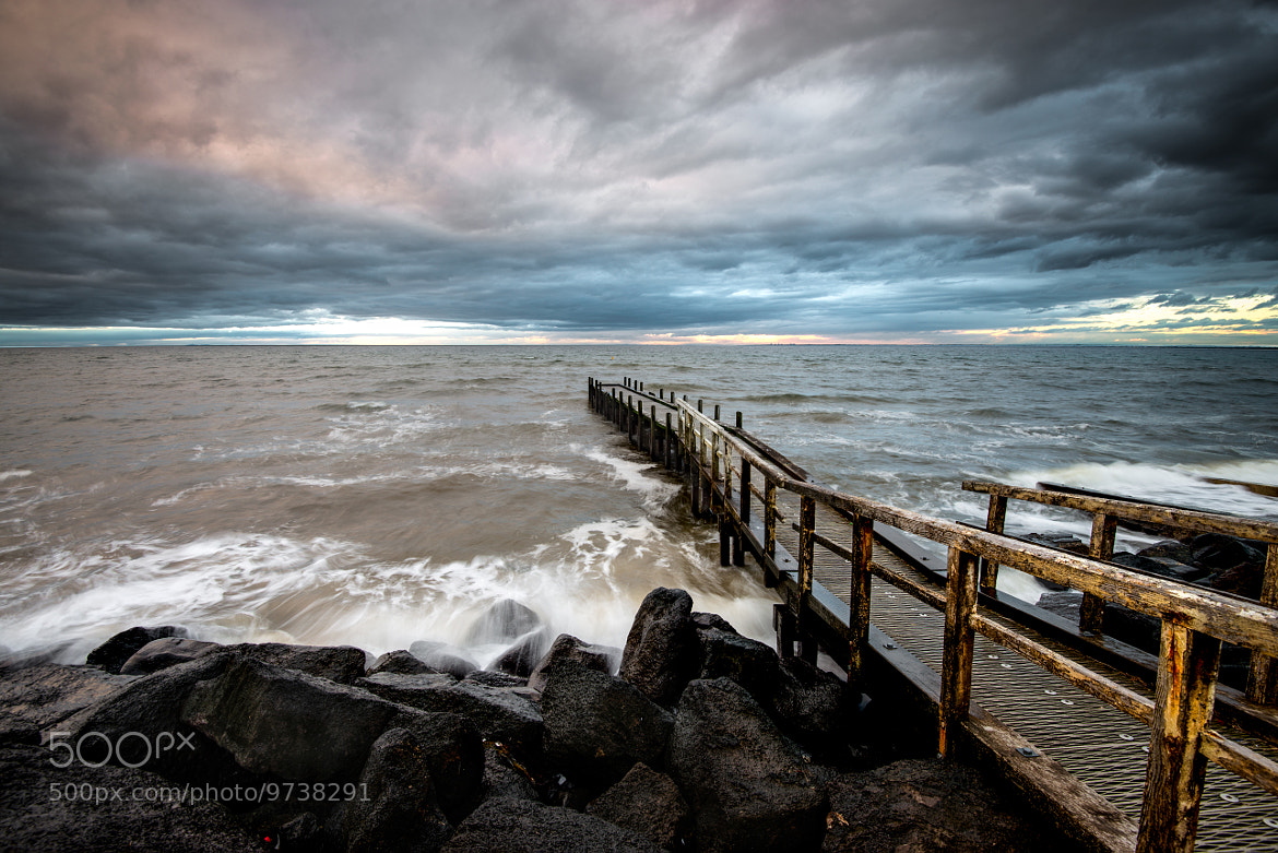 Photograph Stormy Jetty Scene by Andrew Sharpe on 500px