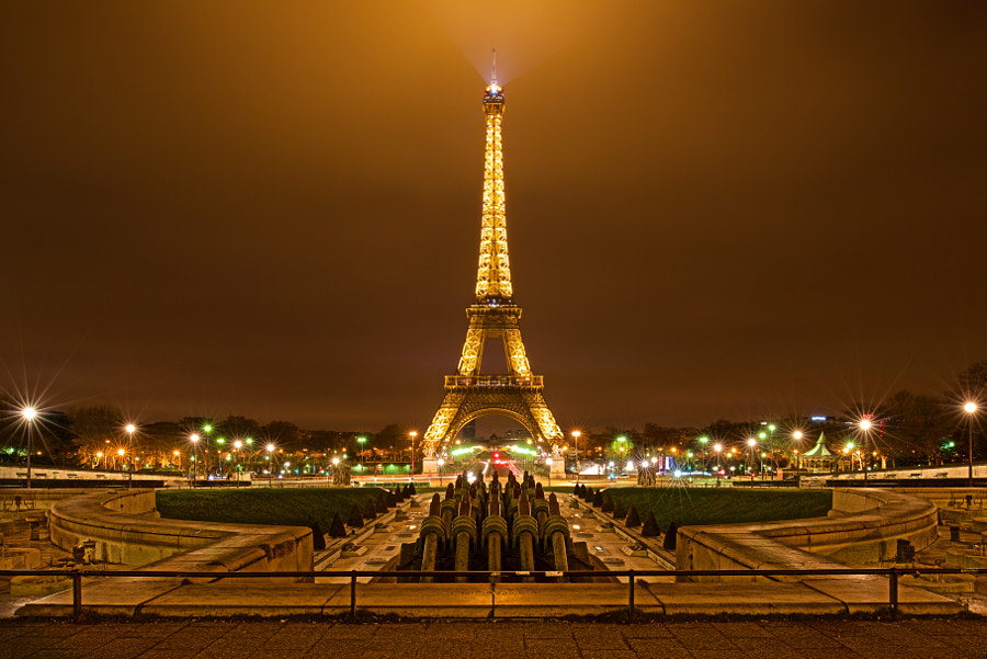 The Eiffel Tower is an iron lattice tower located on the Champ de Mars in Paris. It was named after the engineer Gustave Eiffel, whose company designed and built the tower.  This photo was taken from Trocadero.