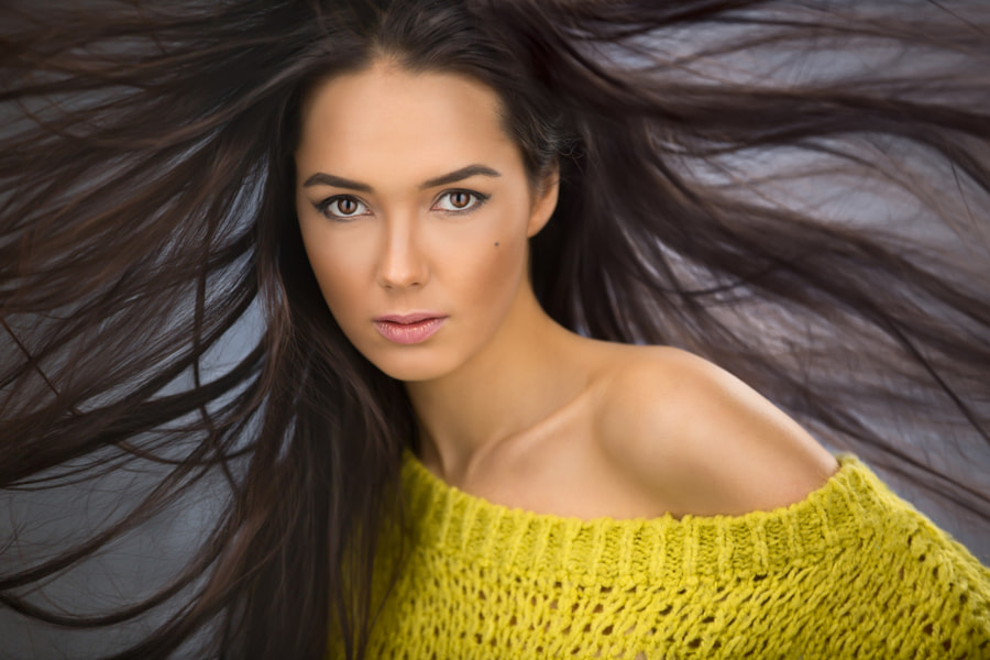 Portrait of a charming sexy brunette with long flowing hair wind by Andrey Bezuglov on 500px.com