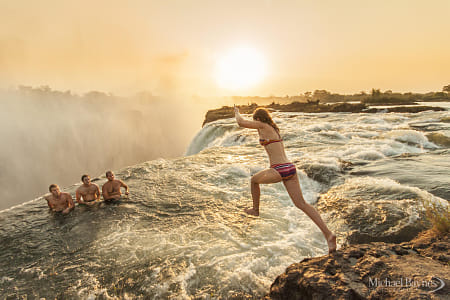 Jumping into Devils Pool by Natta Summerky on 500px