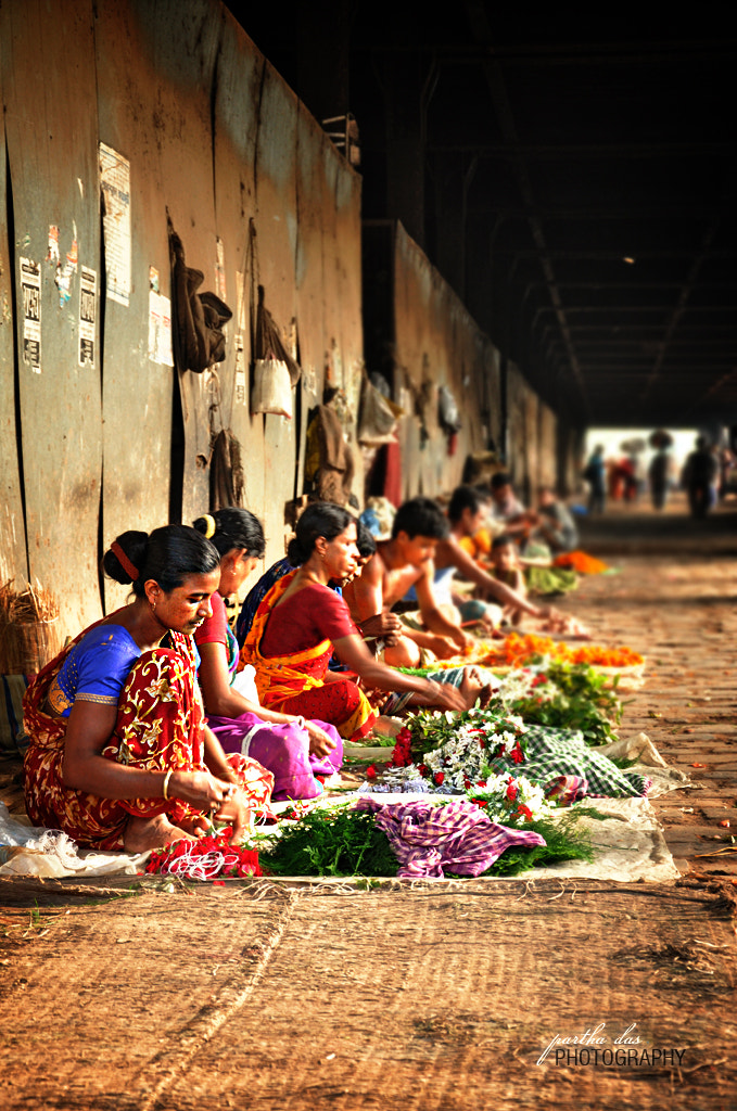Photograph street woman selling flowers! by Partha Das on 500px