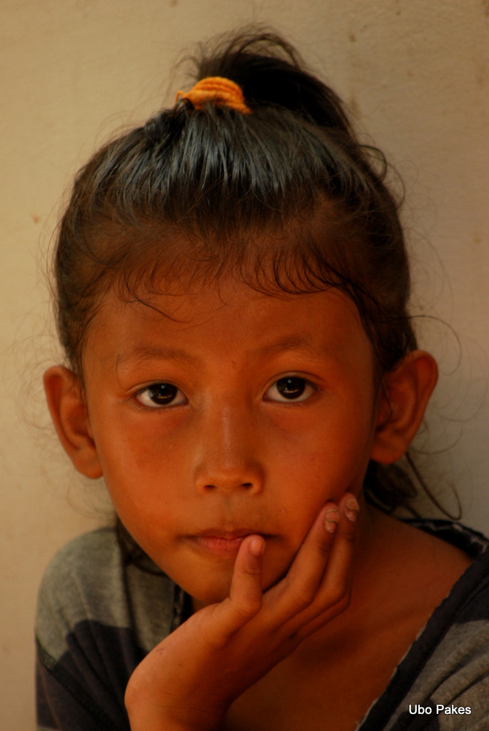 Photograph portrait of a serious young girl by Ubo Pakes on 500px