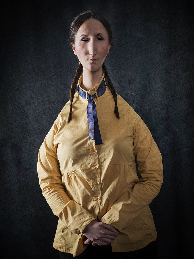Portrait of Woman in Yellow with Braids