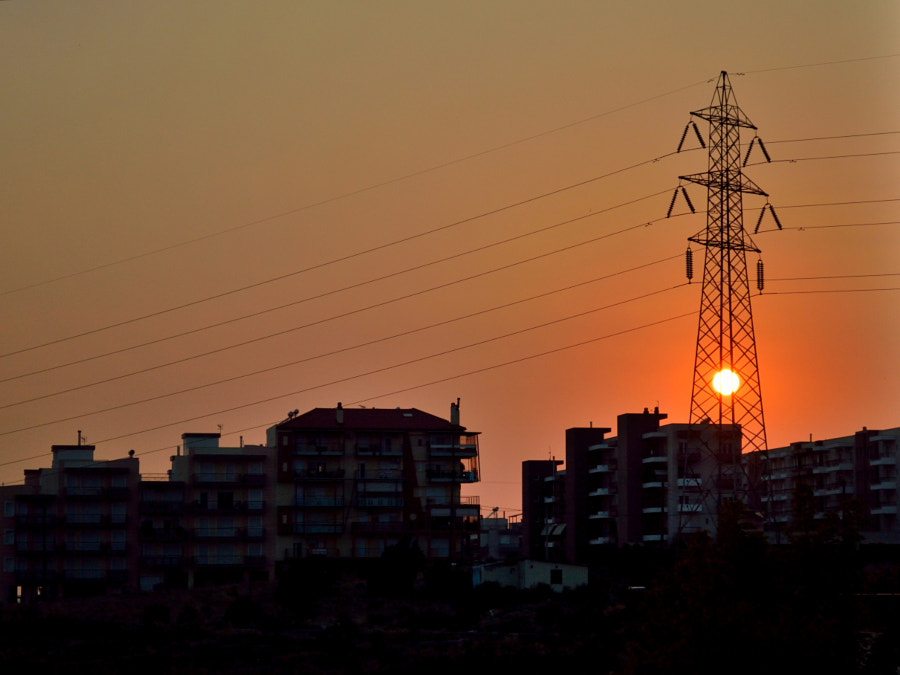 Photograph Urban Sunset behind High Voltage Pole by Papanikolaou Joanna on 500px