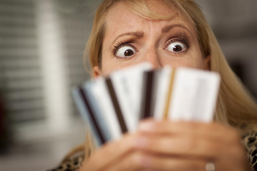 Upset Robed Woman Glaring At Her Many Credit Cards. by Colyer Law Group,  PC Tinley Park on 500px.com