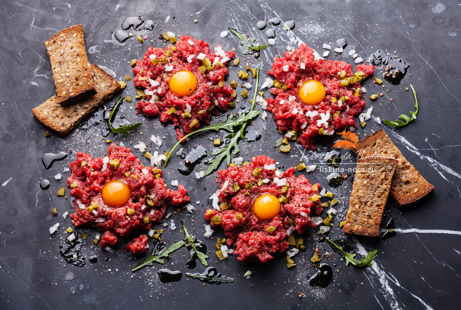 Beef tartare with pickled cucumber and fresh onion