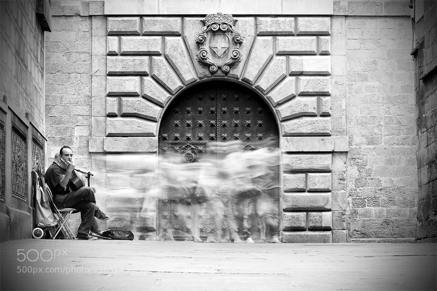 Photograph BCN Street Photo. Guitarist by Juan Novakosky on 500px