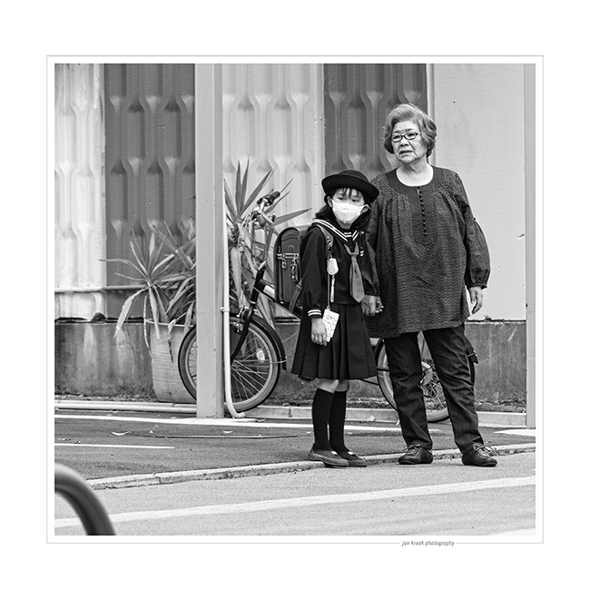 This woman was waiting with her granddaughter for the school bus, somewhere near Tokyo.