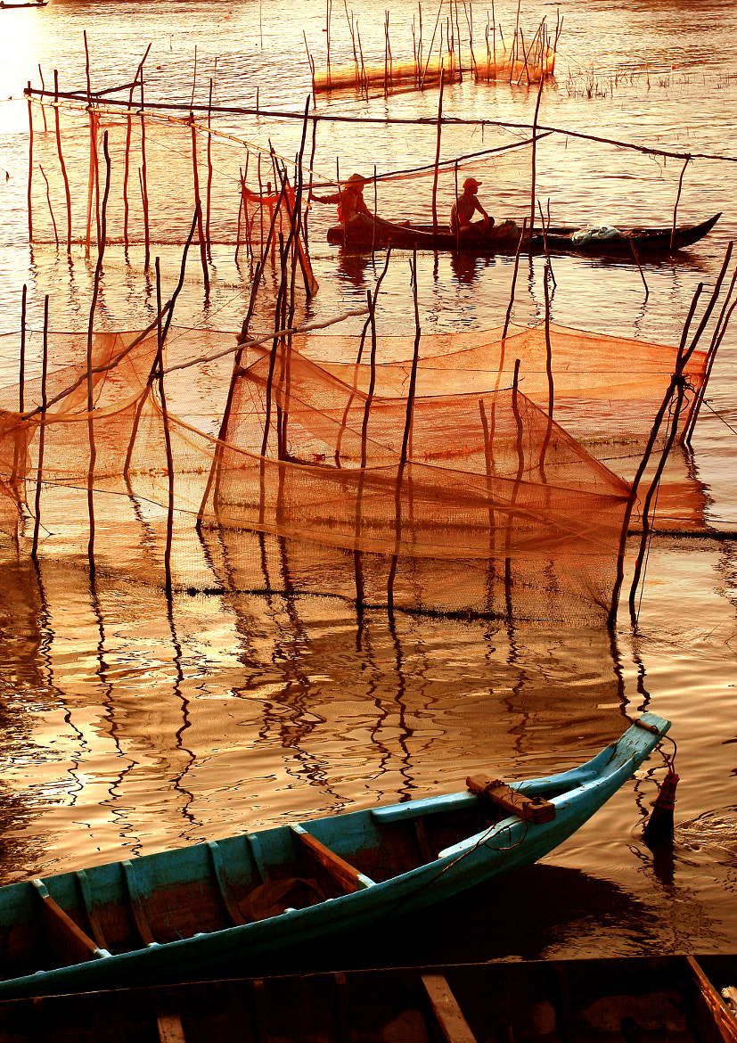 Photograph Fishing for living by Nhan Tran on 500px